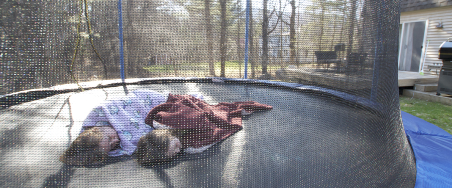 laying with mom on trampoline