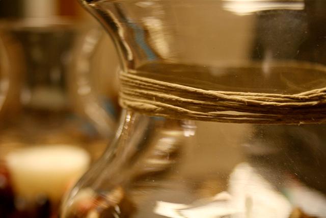 twine around the glass