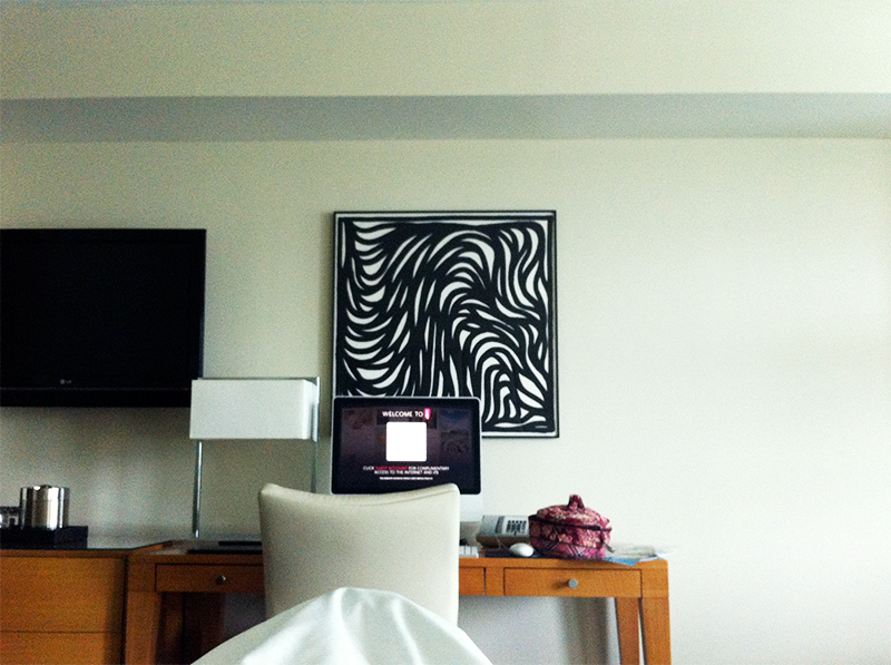 art and apple computer in fountainebleau hotel room