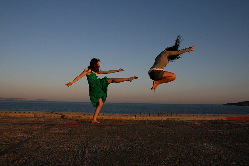 kicking jumping at sunset by the sea