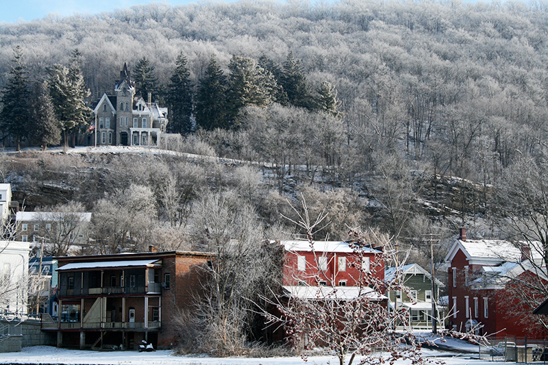 winter new england town with old victorian overlooking