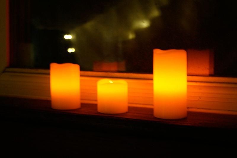 flameless pillar candles in window