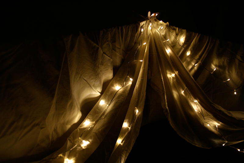 blanket fort with string fairy lights