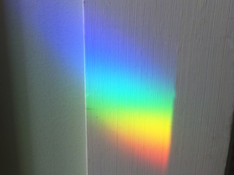 rainbow light reflected on wall