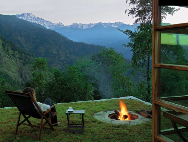 sitting by the fire with mountain views
