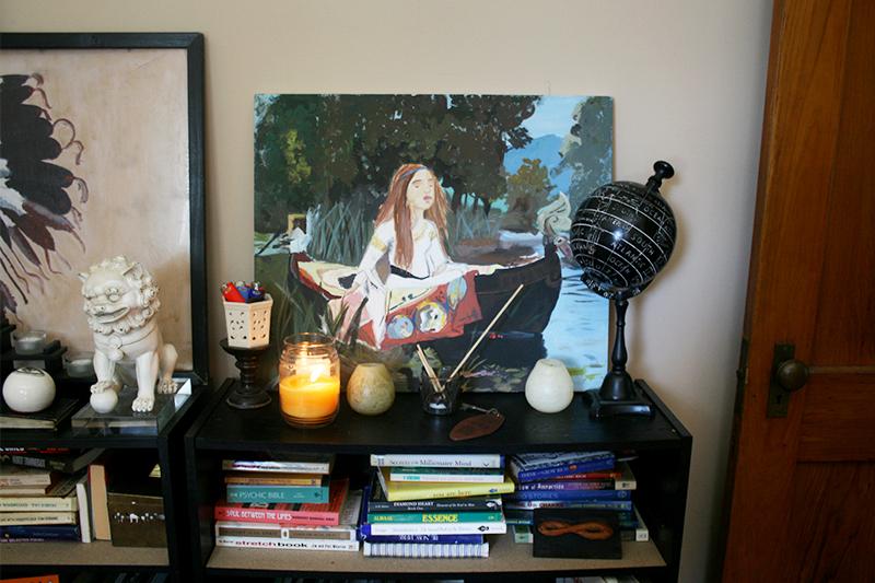 bookshelf decor candle painting globe