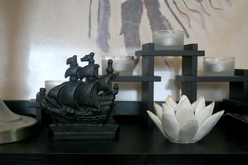 bookshelf decor ship bookend white flower candles
