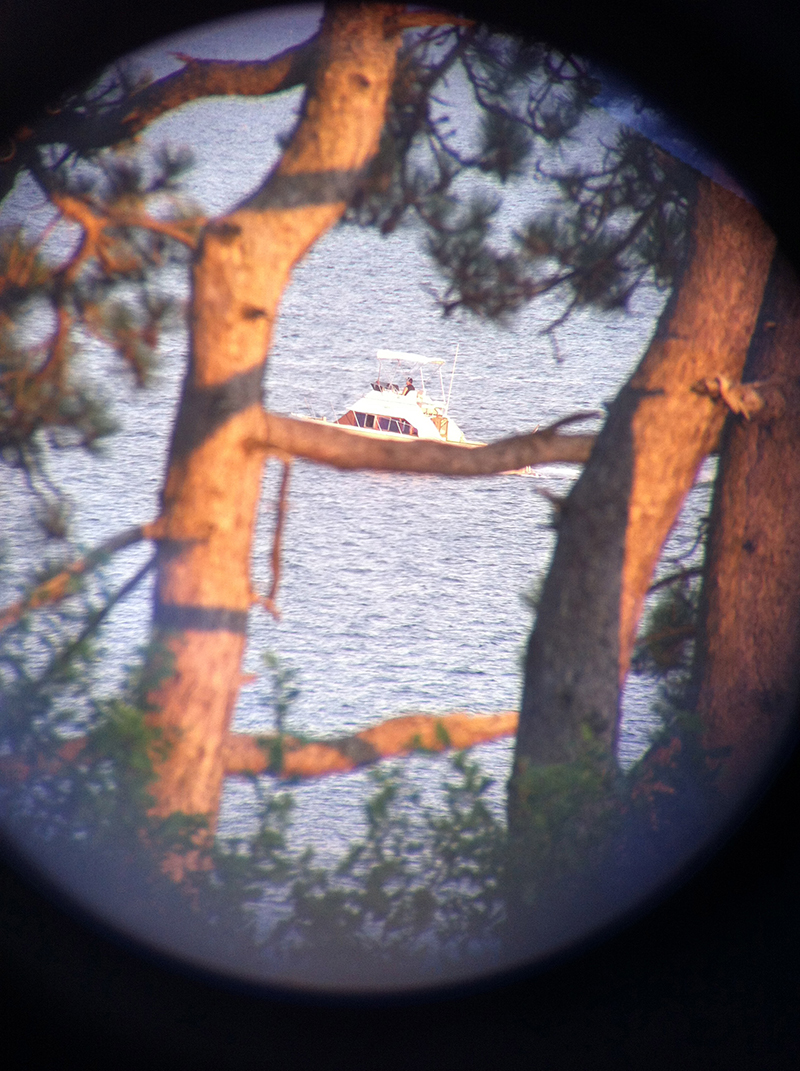 boat through the binoculars