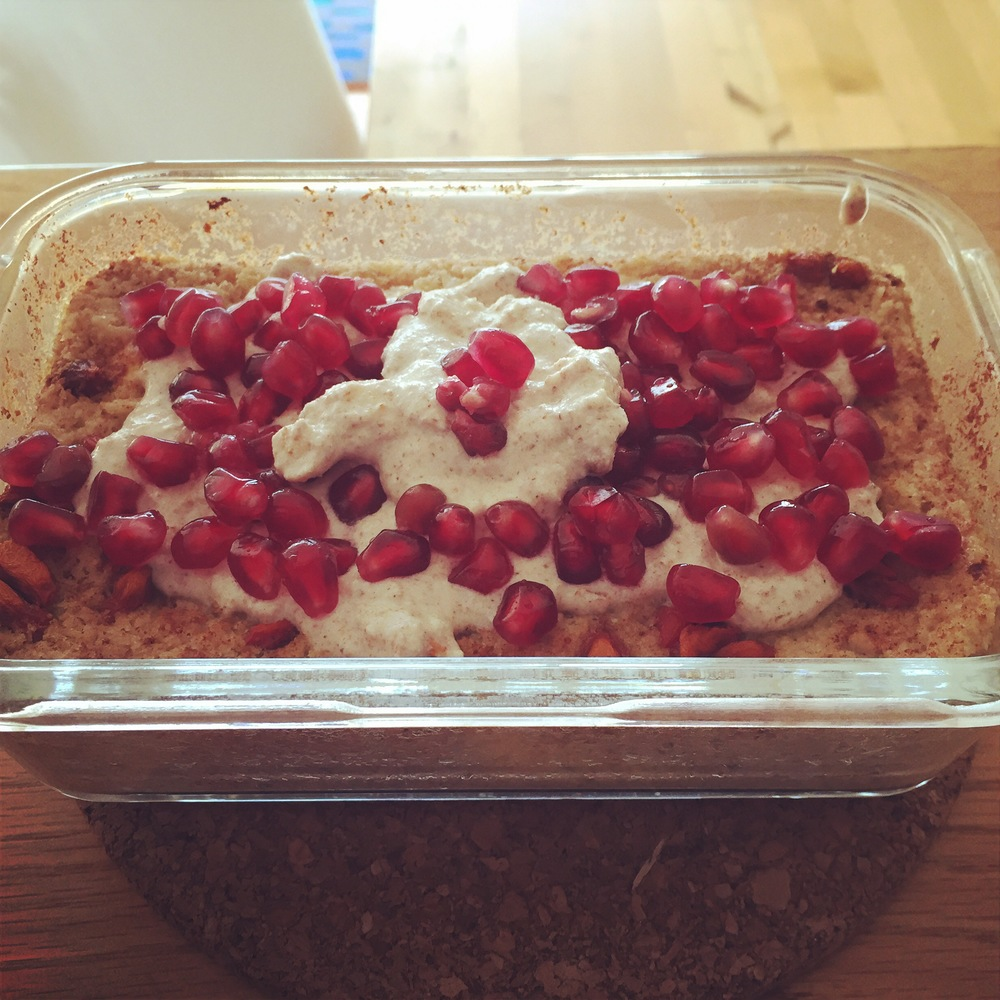 Baked oats with pomegranate and homemade almond creme