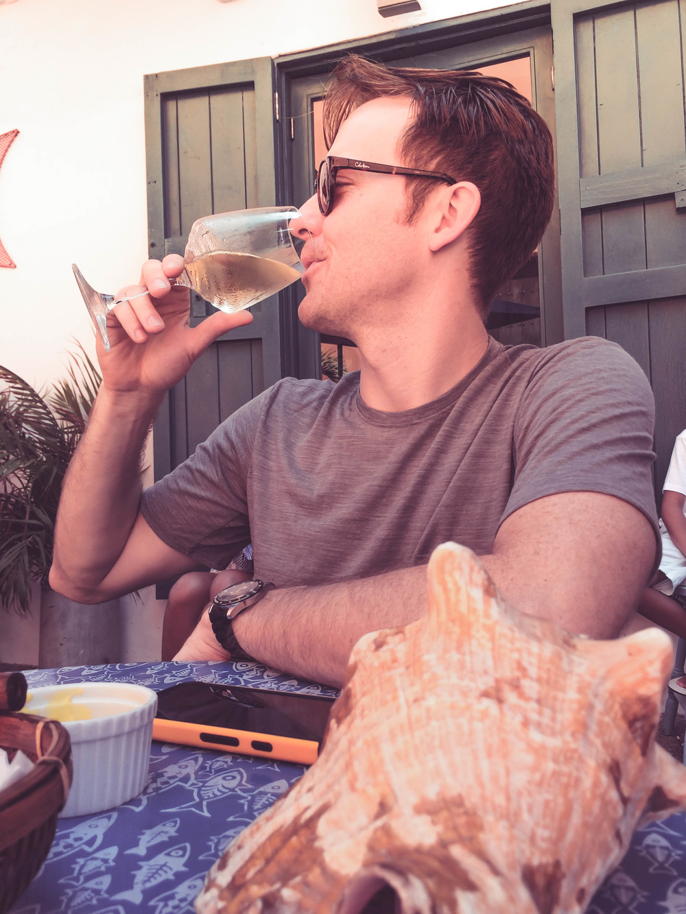 Cartagena- Nate Drinks wine outdoors RTW.jpg