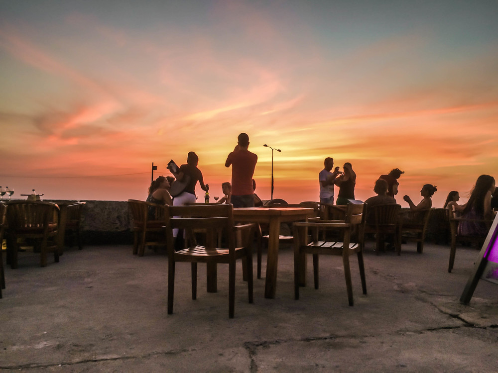 Cartagena- wall at sunset with bar patrons low angle RTW.jpg