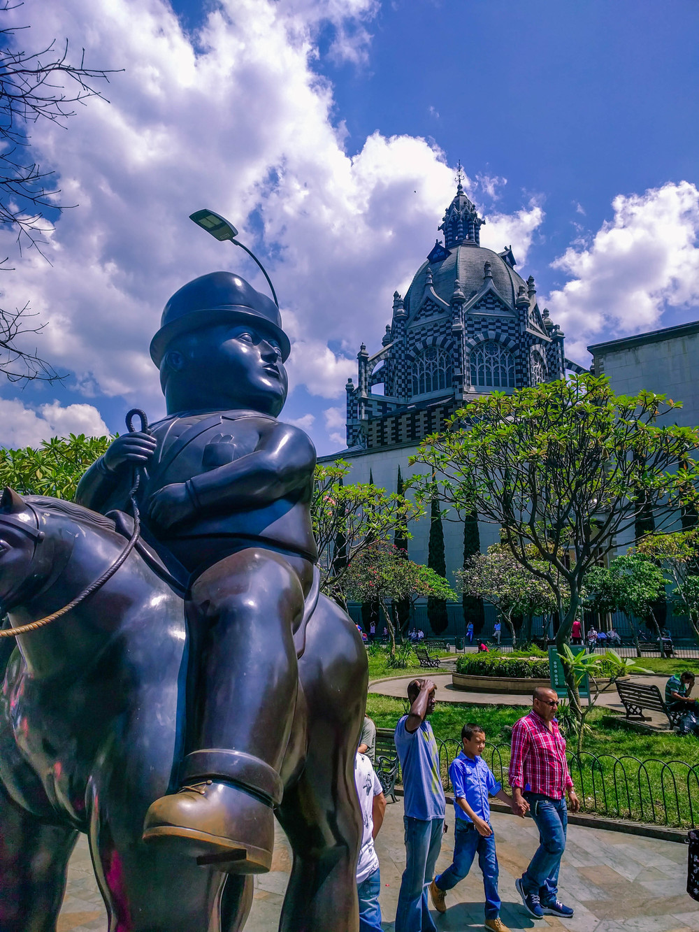 Medellin- botero square horseman looking to church.jpg