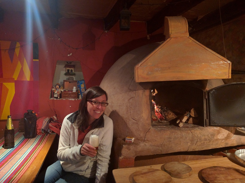 Enjoying a beer and a soccer game in a cozy pizza place in Cusco.