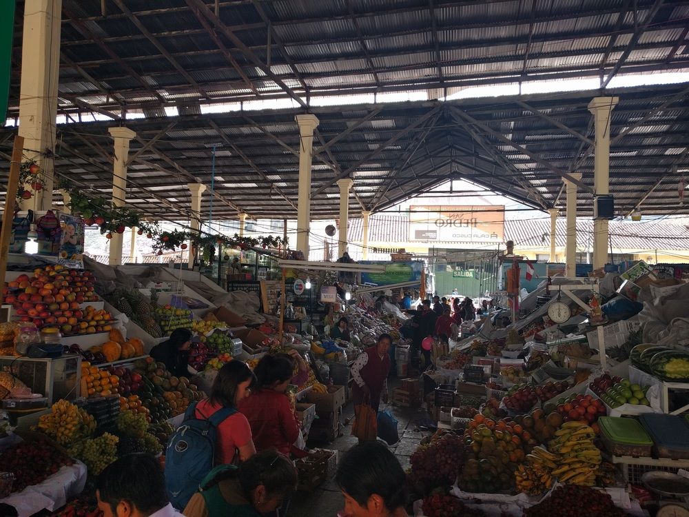 Can you spot me in this local market in Cusco?
