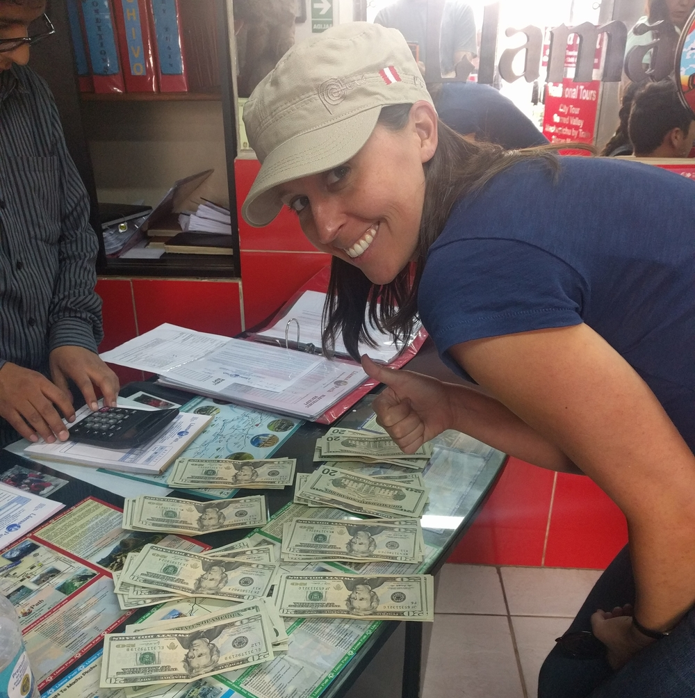 Paying cash for our Inca Trail trek.