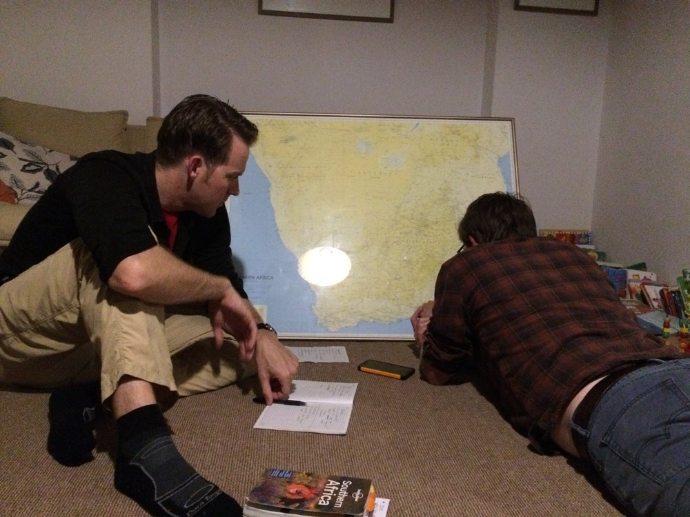 Nate and friend Adam planning out our road trip through southern Africa.