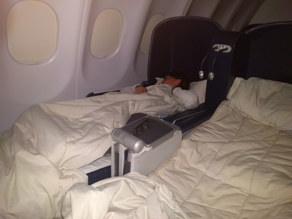 Passed out in our bed/seats on our flight!