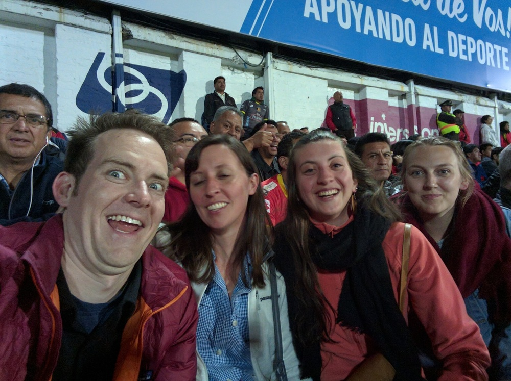 We were at a soccer game in Ecuador.  Nate's face is the best.