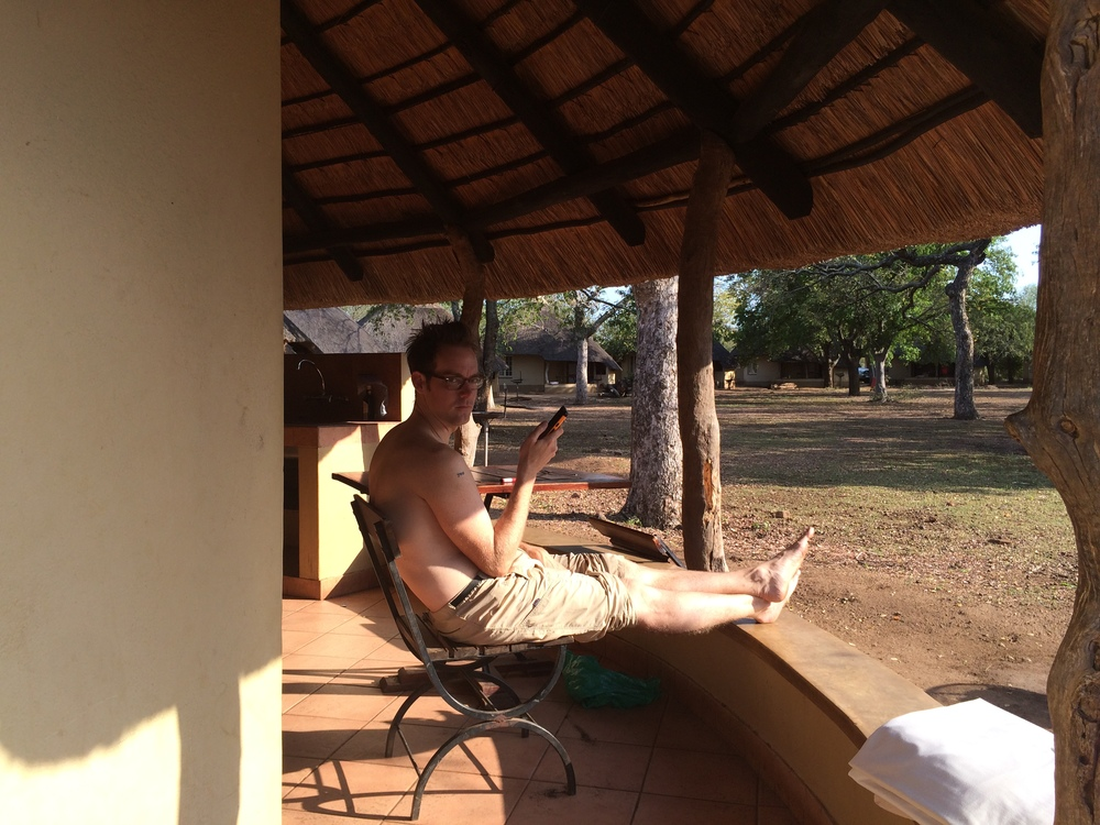 Just a topless man enjoying some alone time with his phone at Kruger National Park.