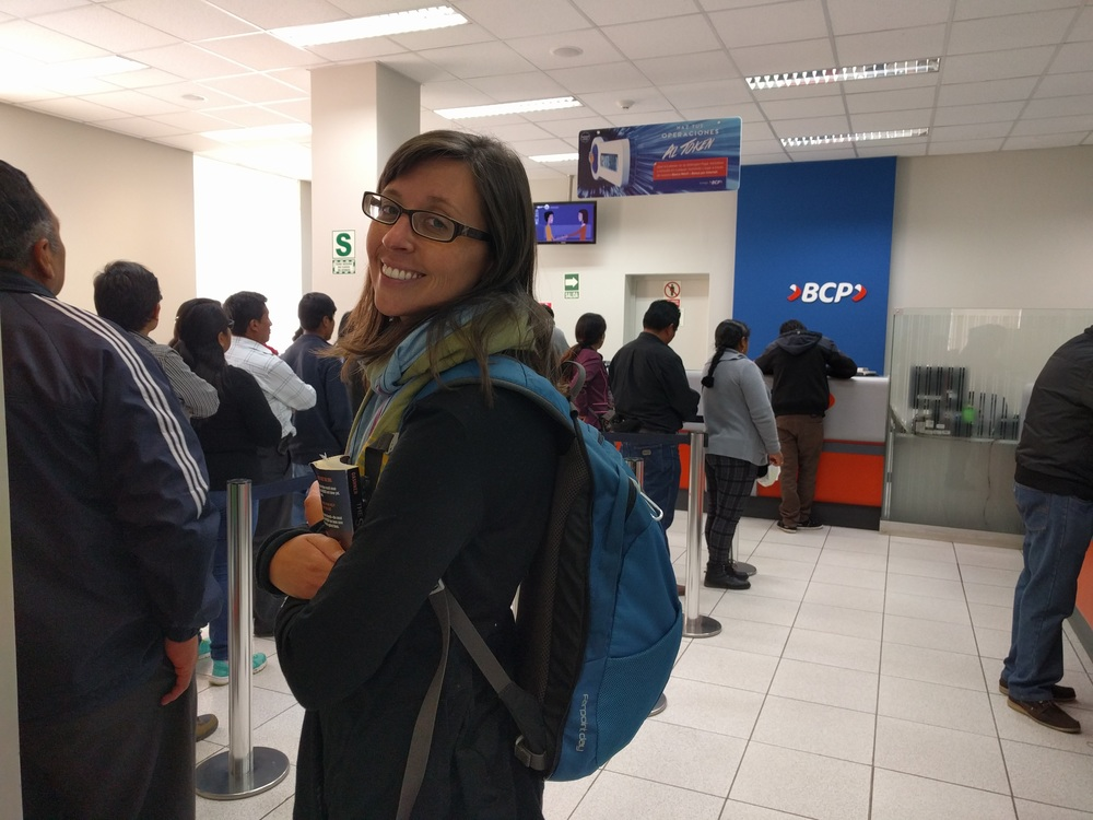 Waiting in line at the bank in Peru to pay for Visas after FOUR visits to the Bolivian Consulate.
