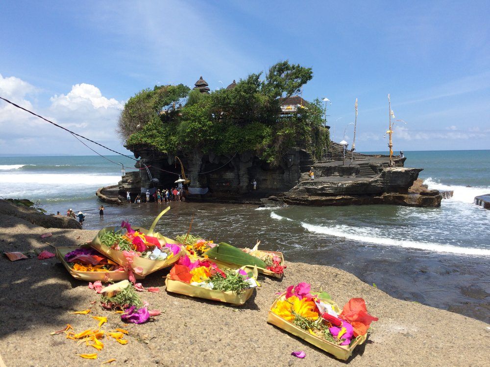 Hindu offerings on a cliff by Tanah Lot, the sea temple.