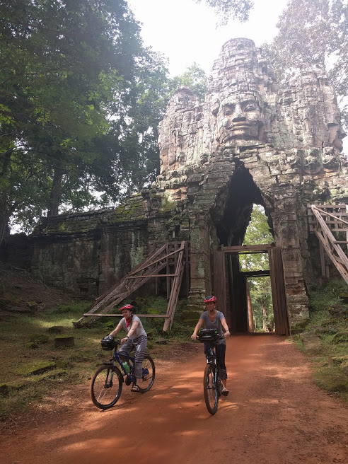 Me and Amanda (Nate's sister) biking through a temple entrance.
