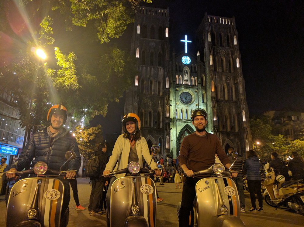 Riding Vespas in downtown Hanoi.