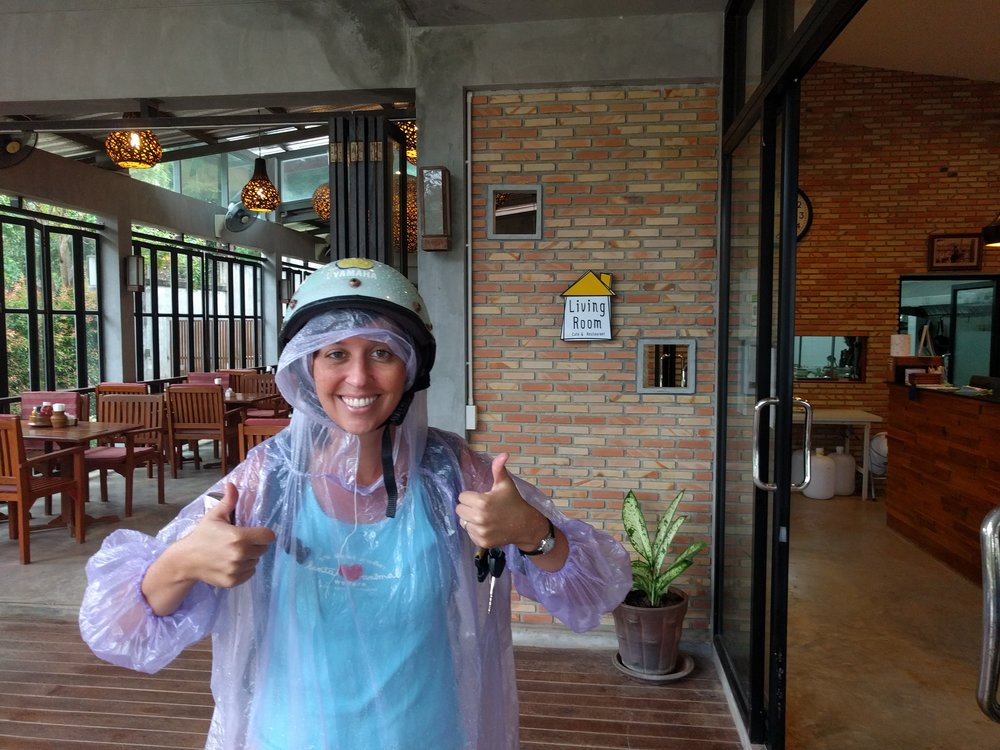 Jess on a rainy morning commute in Koh Lanta.