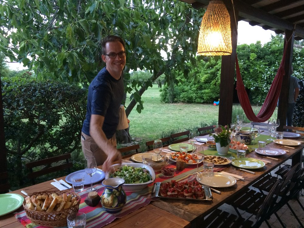 Nate setting the table at our workaway in Tuscany.