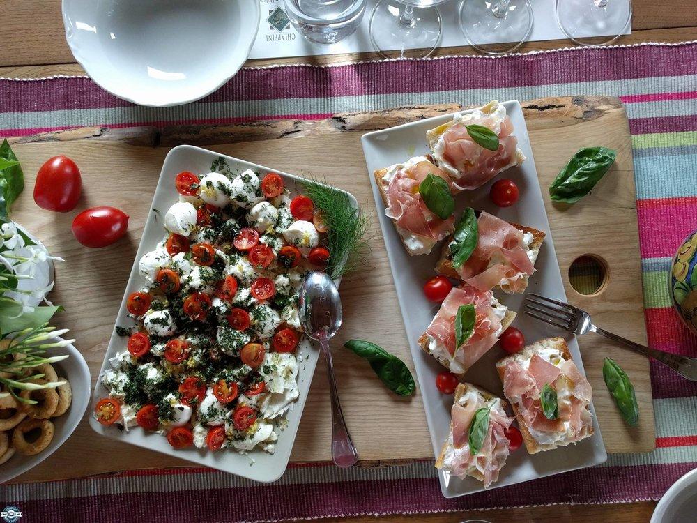 Prosciutto bruschetta and fresh tomato and mozzarella salad we served at the cooking school.