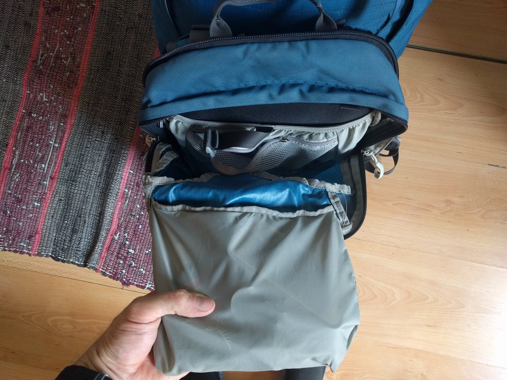 The only readily accessible pocket on the Osprey Farpoint 55 once it is attached is this quart sized zippered pocket at the top of the daypack.