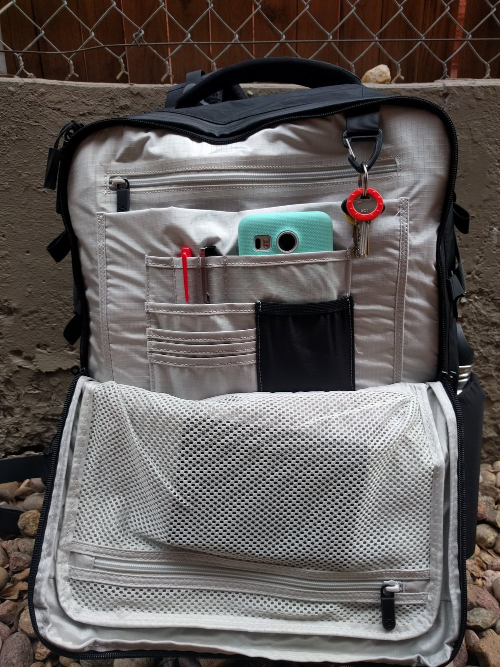 The front organizational pocket is a big improvement from Tortuga's original travel bag. My only complaint is that black piece of fabric which, while stretchy, was not large enough to hold my medium sized Nexus 5x. Travelers with a Pixel XL or iPhone Plus will find these phone spaces completely inadequate.