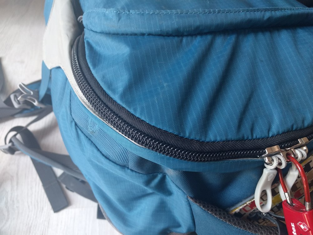 The Osprey Farpoint 55's zippers are chunkier and more solidly stiched, though definitely not water-proof.