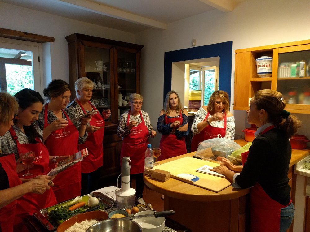Chicca running a cooking class in her kitchen