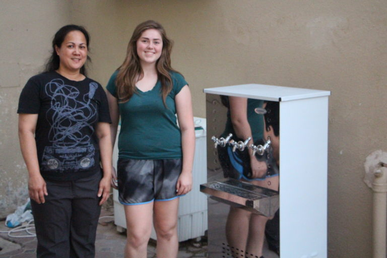 Geraldine and Julia Grifferty next to the newly installed water dispenser donated by Boot the Bottle
