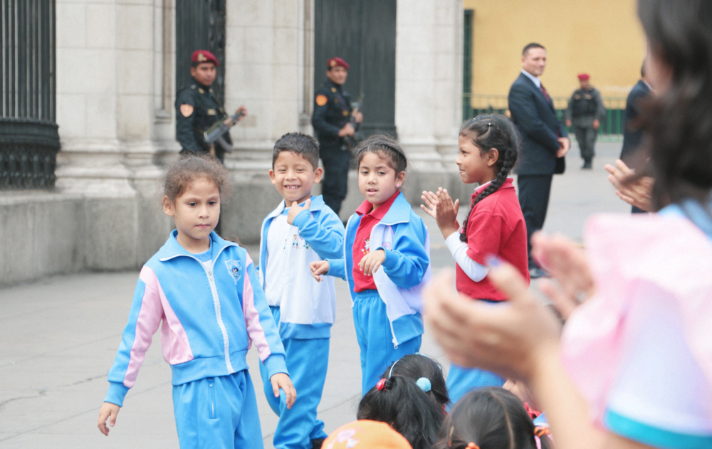 "Palacio de Gobierno: Some kids gather around to see the ""change of command"" of the guards (something that happens every day at noon) and it's a whole ordeal."