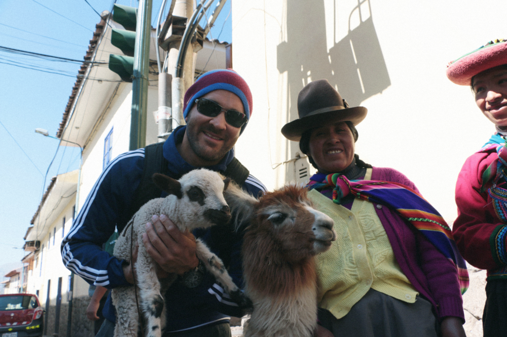 "Pablo holding a ""corderito""  next to a llama who was skeptical asf"
