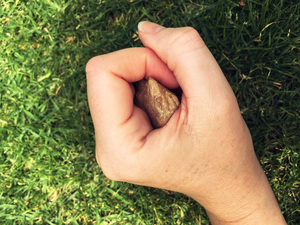 HOLDING AND BLOWING INTO A MEDICINE STONE