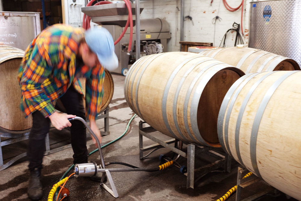 Cleaning the oak barrels with hot steam