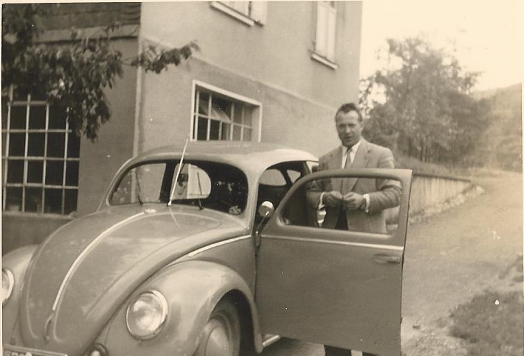 First company car, a VW Beatle, with company director and owner Helmut Lind , in the early 1950's