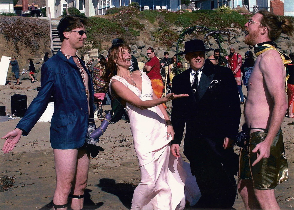Our wedding, from left: Moorlock, Mrs. Catharine Winn, yours truly and the late, great Gregorio Redbeard Junell. October 8th, 2005. For the record, co-best man David Holthouse can be seen in the background, just to the right of cross-dressed Robert Kaye in red (above the tiki torch).