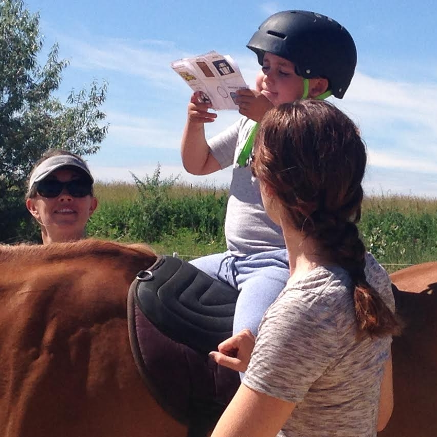 Cathy Lauderbaugh uses hippotherapy to incorporate motivating speech therapy activities into her private speech therapy sessions in Boulder County Colorado.