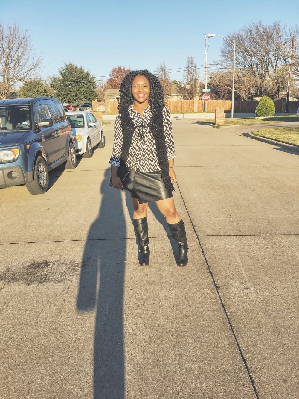 """Outfit details: Chevron shirt-H&M, Shabby vest-Urban Outfitters, Split Hem """"Leather"""" skirt-Cotton On, Black silver buckle boots-JustFab, Black clutch-Gifted?"""