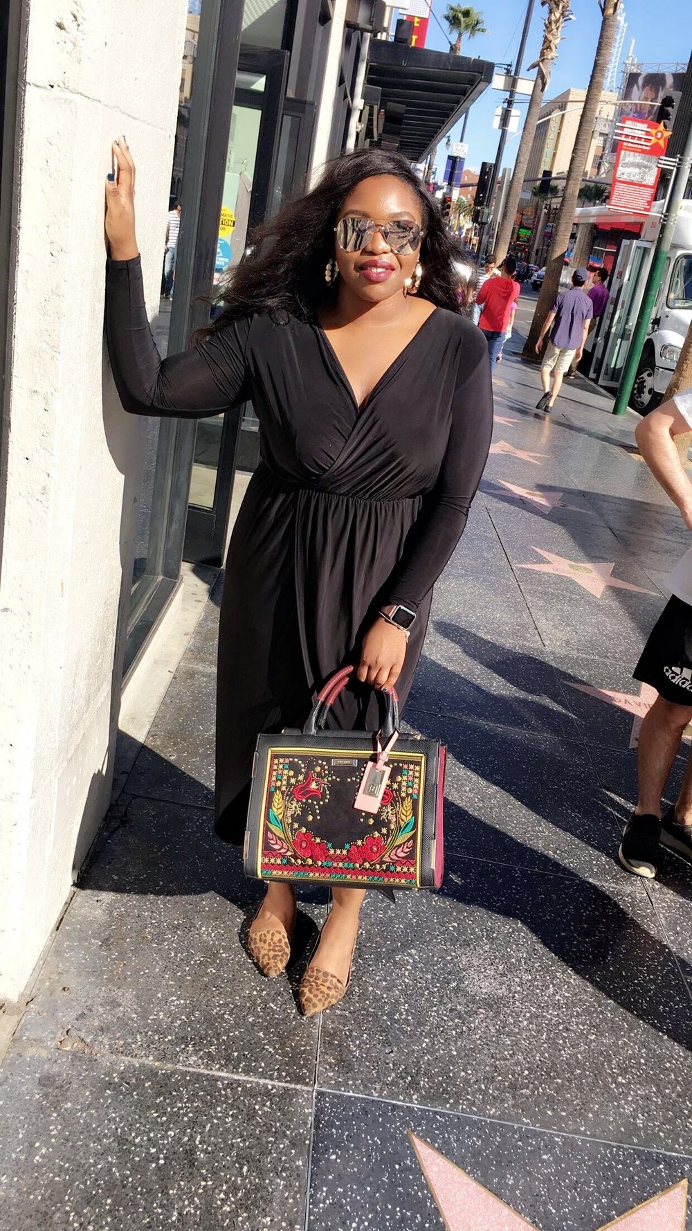 """Outfit details: Dress- Boohoo, Bag-River Island, Earrings- H&M, Sunglasses- """"High Key"""" by Quay Australia X Desi Perkins   To the right is Kevin Hart's star-- had to show my favorite comedian some love!"""