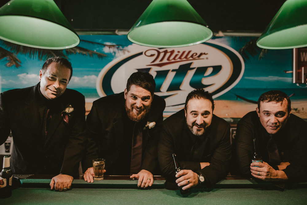 Groomsmen at pool table