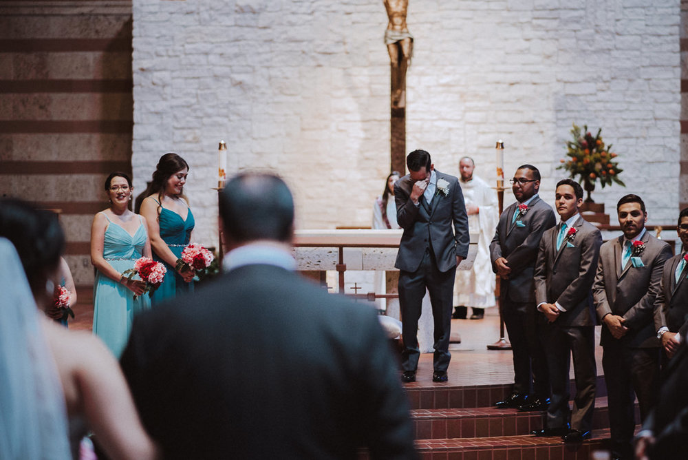 Emotional groom sees his bride