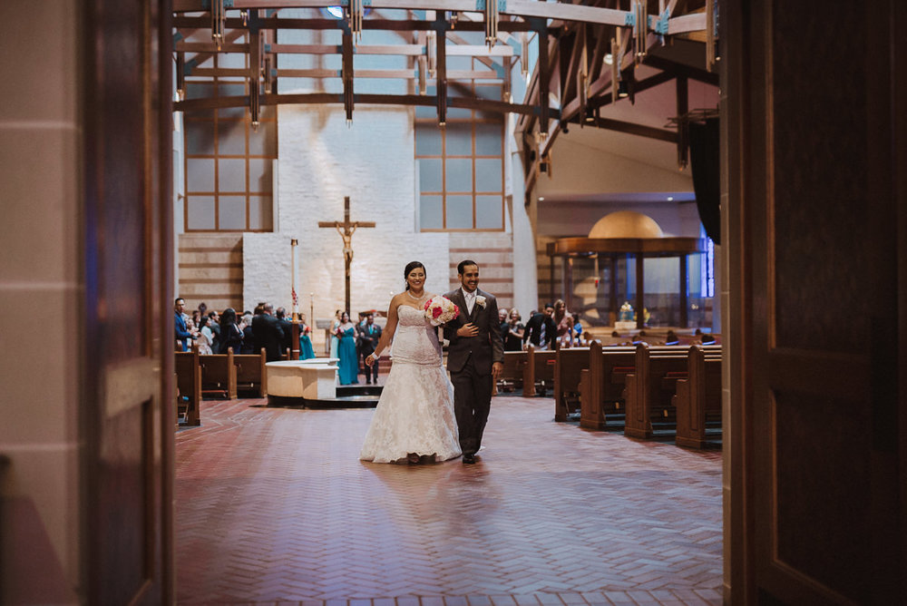 Bride and Groom walk down the aisle in Houston Texas