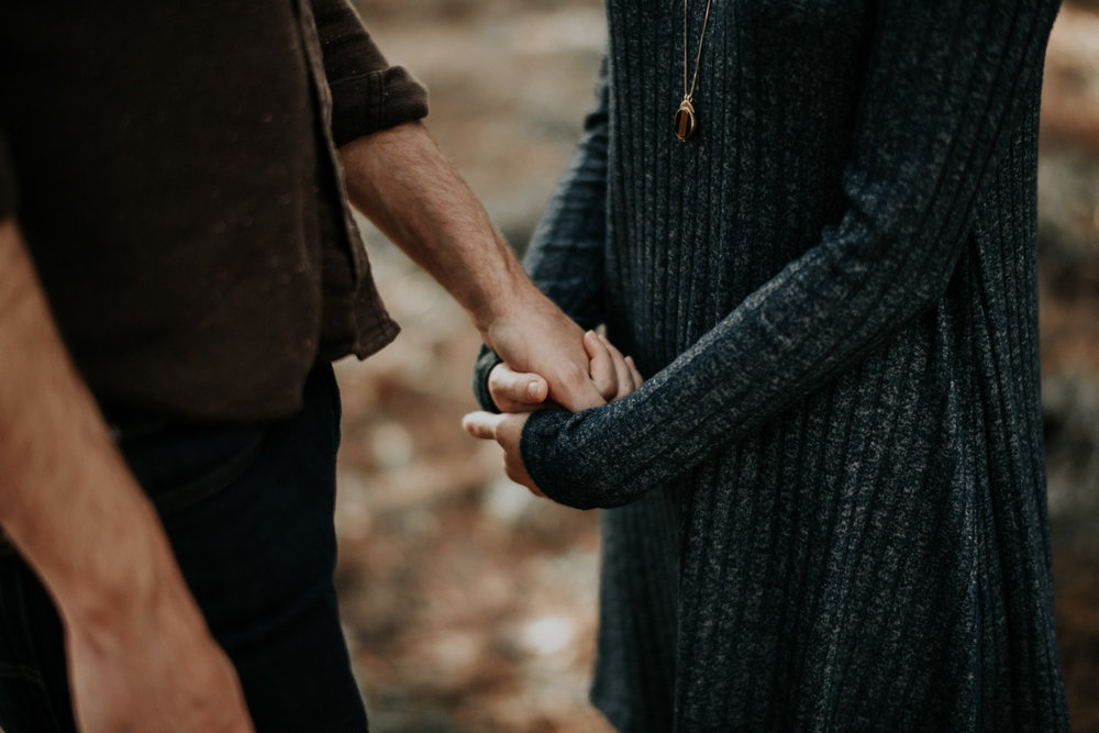 Couple Holding Hands at Engagement Session