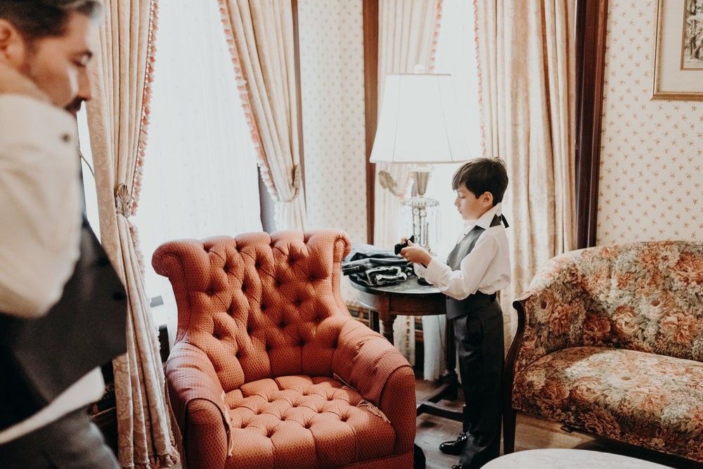 groom and son getting ready at wedding