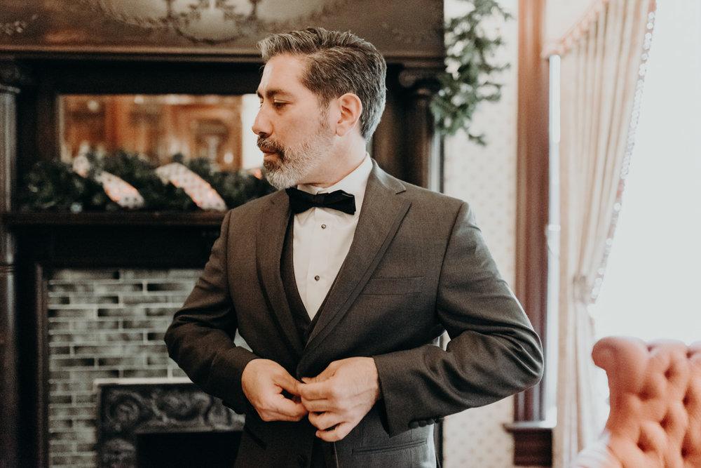 groom in grey vera wang tuxedo at austin wedding
